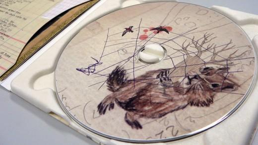 CD packaging, cd artwork, Go Go Smear, hypnotic packaging, creative cd case, CD Packaging: MUM- Go Go Smear the Poison Ivy
