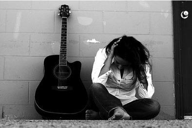 sad woman guitar