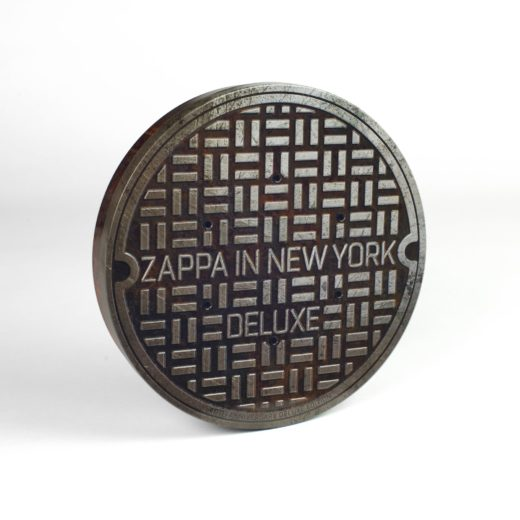 CD Packaging Zappa in New York manhole