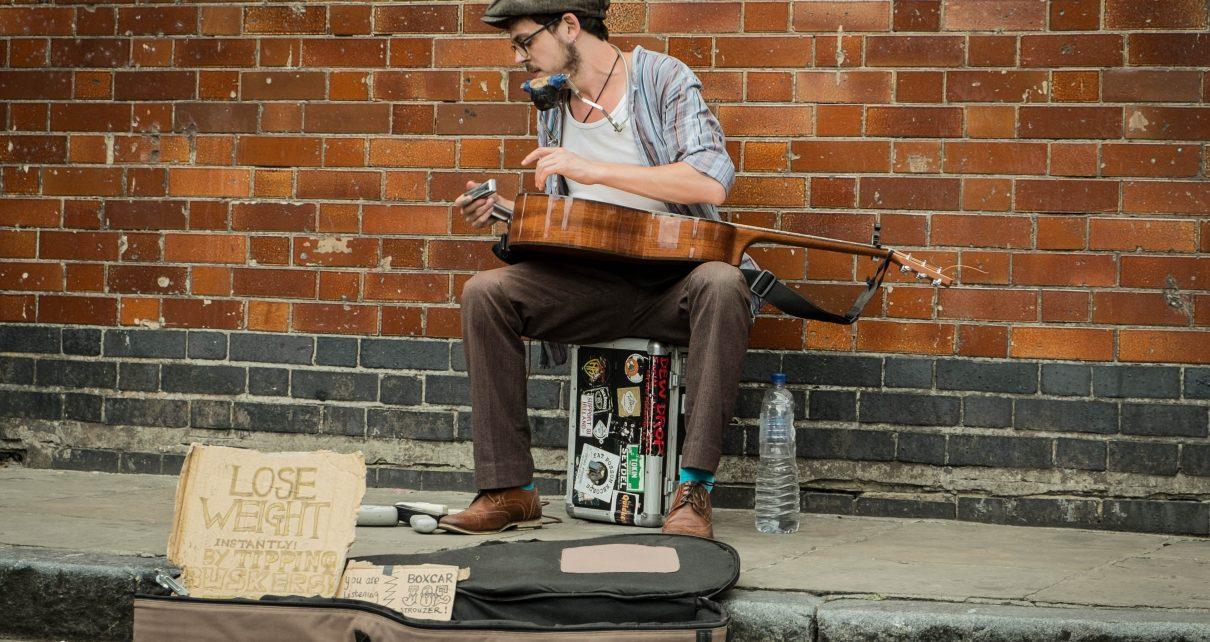 musician busking money